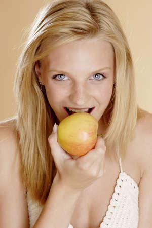 Woman biting an apple. Stock Photo - 3191166