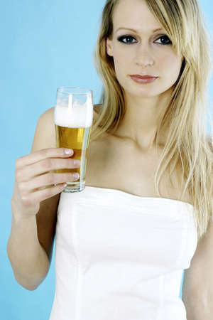 Woman holding a glass of beer. Stock Photo - 3191167
