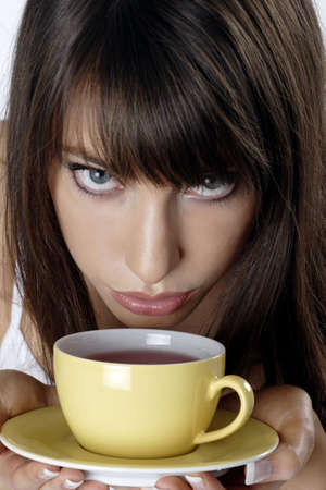 Woman holding a cup of tea.
