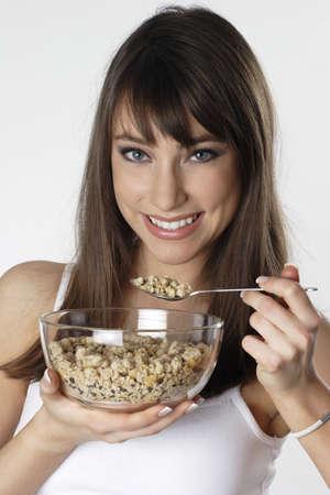Mujer desayunando cereales.  Foto de archivo - 3191173