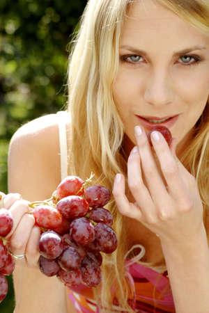 Woman eating grapes. Stock Photo - 3191176