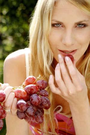 Woman eating grapes. Stock Photo - 3191176