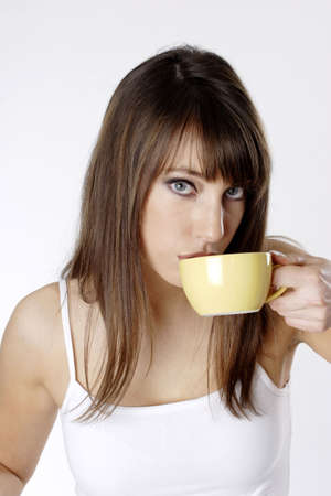 Woman drinking a cup of coffee. LANG_EVOIMAGES