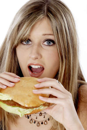 Woman about to bite on a burger. Stock Photo - 3191192