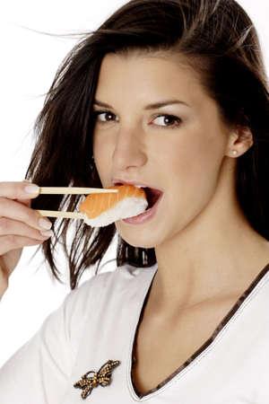 Woman eating japanese food.