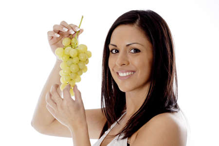 important people: Woman holding green grapes. LANG_EVOIMAGES
