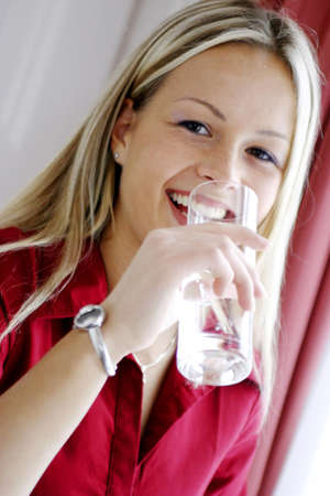 Woman drinking a glass of water. Stock Photo - 3191214