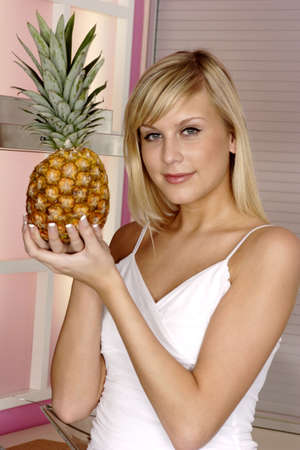 Woman holding a pineapple. Stock Photo - 3191223
