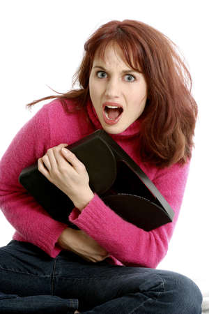 safekeeping: Woman protecting her bag. LANG_EVOIMAGES