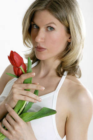 Woman holding flowers. Stock Photo - 3191255