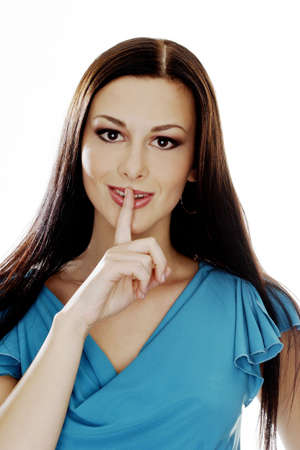 Woman showing a hushing sign. Stock Photo - 3191258