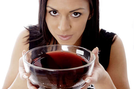 Woman drinking a bowl of red wine.