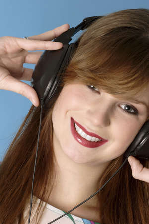 expressive mood: Woman listening to music on the headphones.