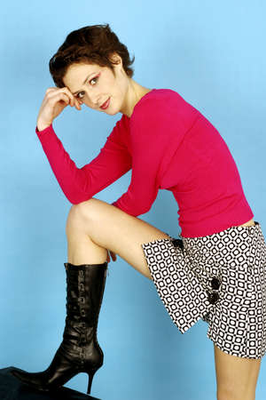 Fashionable woman striking a pose for the camera. Stock Photo - 3191294