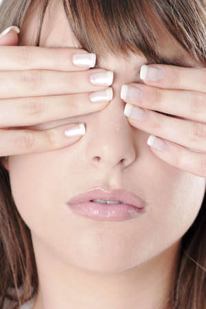 Woman covering her eyes with her hands. Stock Photo - 3191304