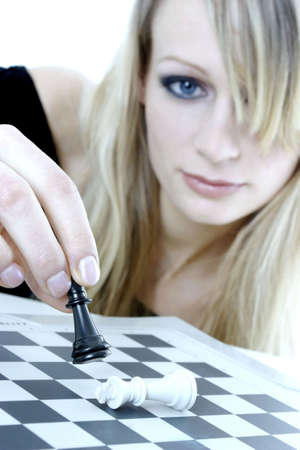 Woman playing chess game. LANG_EVOIMAGES