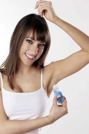 Woman applying deodorant on her underarm. Stock Photo - 3191311