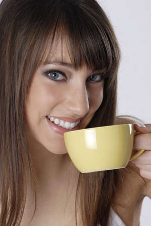 tea hot drink: Woman drinking a cup of coffee. LANG_EVOIMAGES