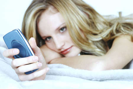 Woman text messaging on her mobile phone. Stock Photo - 3191318