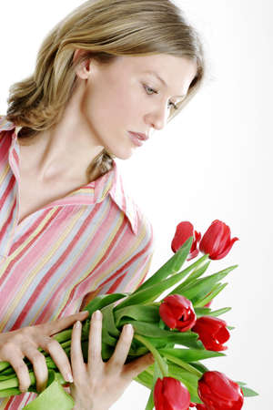admiring: Woman holding flowers. LANG_EVOIMAGES