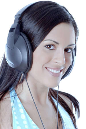 Woman listening to music on her headphone. Stock Photo - 3191327