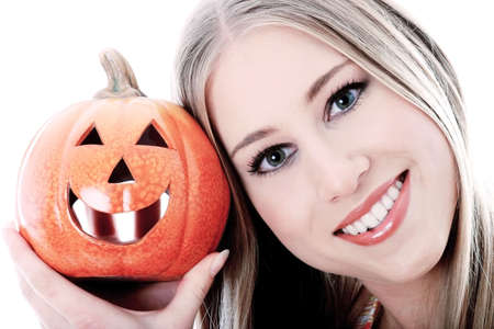 Woman holding a carved pumpkin. Stock Photo - 3191338