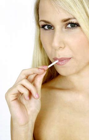 Woman eating lollipop. Stock Photo - 3191344