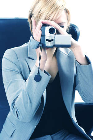 Businesswoman taking video with a video camcorder. Stock Photo - 3191352