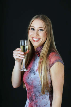 Woman in cheongsam holding a glass of wine. Stock Photo - 3191359