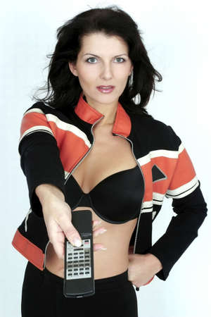 inner wear: Woman in bra and jacket using remote control.