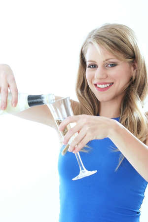 alcoholic drink: Woman pouring wine into a glass.