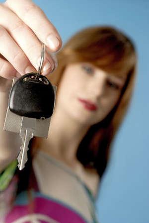 Woman holding a key. Stock Photo - 3191375