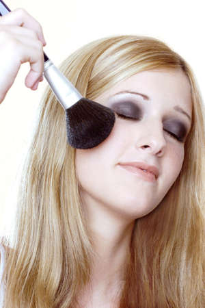 Woman applying loose powder on her face. Stock Photo - 3191392