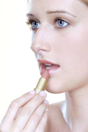 Woman applying lipstick. Stock Photo - 3191393
