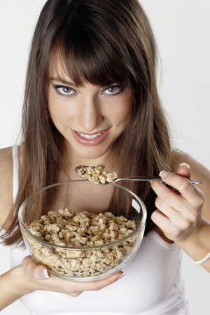 Woman eating breakfast cereal. Stock Photo - 3191396
