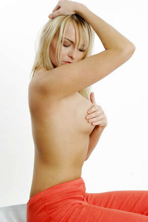 Woman doing her monthly breast self-examination. LANG_EVOIMAGES