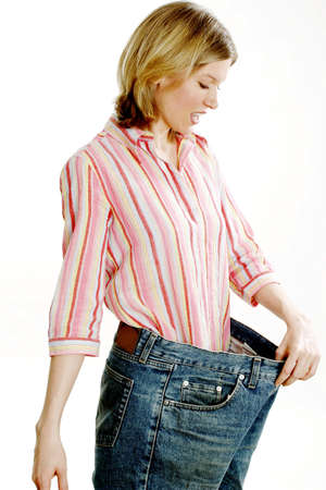 oversized: Woman in her old jeans after losing weight.