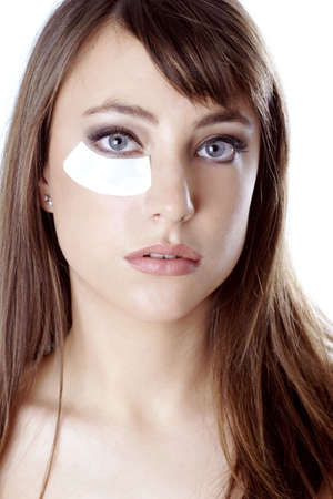 Woman doing under-eye treatment. Stock Photo - 3191427
