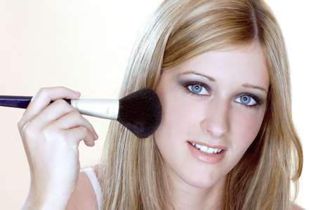 Woman applying loose powder on her face. Stock Photo - 3191429