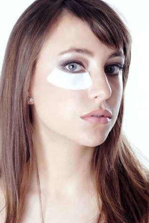 Woman doing under-eye treatment. Stock Photo - 3191446