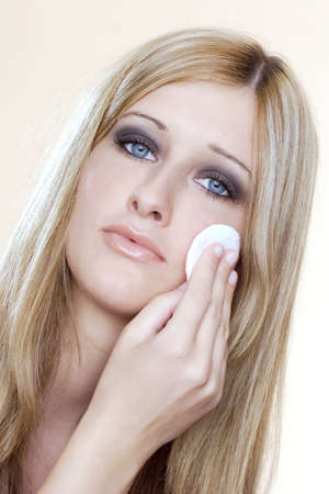 Woman applying powder foundation on her face. Stock Photo - 3191456