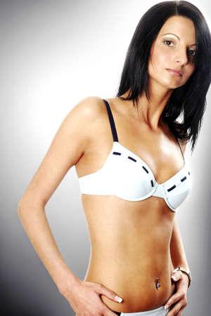 arousing: Woman in bikini posing for the camera.