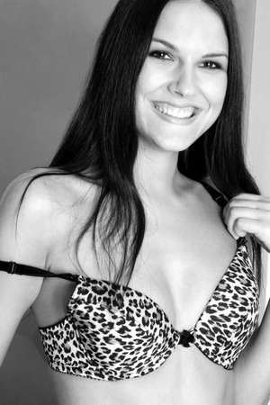 inner wear: Woman in leopard skinned bra smiling at the camera.