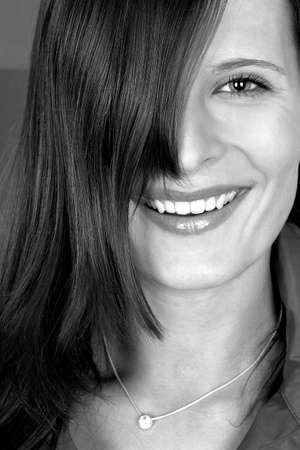 captivation: Close-up picture of woman smiling.