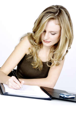 Businesswoman writing report. Stock Photo - 3191552