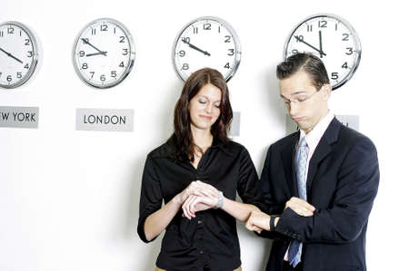 Corporate people checking the time. Stock Photo - 3191555