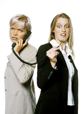 Businesswoman talking on a disconnected woman. LANG_EVOIMAGES