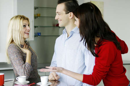 introducing: Woman introducing her boyfriend to her best friend.