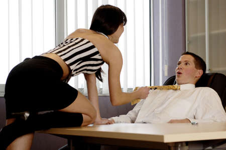 Woman seducing her manager. Stock Photo - 3191565