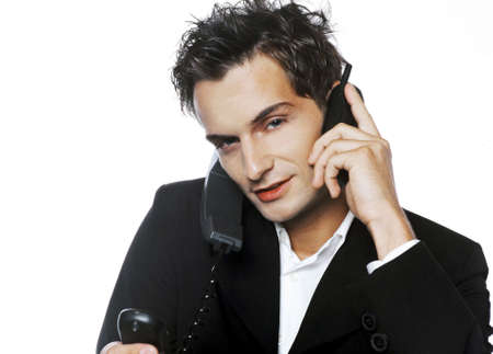 Businessman busy answering phone calls. Stock Photo - 3191569
